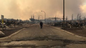 A Mountie surveys the damage on a street in Fort McMurray, Alberta, Canada in this May 4, 2016 image posted on social media. (Alberta RCMP/Reuters)